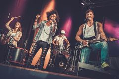 Free Music Band Performing On A Stage Royalty Free Stock Photography - 59011607