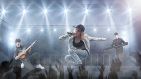 Music band is performing on stage. Music bnd with female singer giving a concert on a stage royalty free stock image