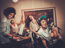Music band performing in a studio Stock Image