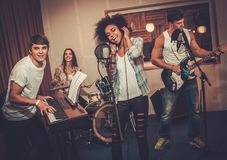 Music band performing in a studio Royalty Free Stock Photos