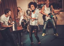 Music band performing in a studio Stock Photos