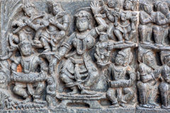 Music band playing and dancing in traditional Indian form. Relief of the 12th century Hindu temple, India Stock Image
