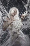 Music. Beautiful model with long white hair Stock Photography
