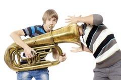Music birth. Fun boys enjoy with a tuba Royalty Free Stock Photo