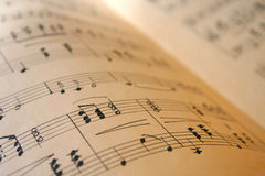 Music book. Music notes book with grunge paper Stock Images