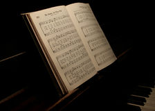 Music book. Hymnal open on old piano Royalty Free Stock Photos