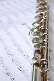 Music book and flute Stock Photography