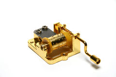 Music box. Golden music box on white background royalty free stock images
