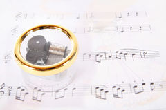 Music box. A transparent music box with the music background royalty free stock image