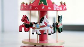 Music box horse white merry go round red carousel horses toy closeup