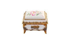 Music box. Small antique music box, gold trim with flowers on the top royalty free stock photography
