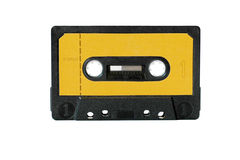 Music cassette tape. Cassette tape with orange label isolated on white Royalty Free Stock Image