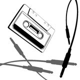 Music cassette vector. Vector graphic with music cassette old style and jack cable Royalty Free Stock Photos