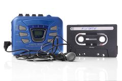 Music cassette and walkman. Old-fashioned music cassette and walkman player with earphones Royalty Free Stock Image