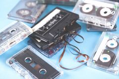 Music cassettes on the blue table background stock photo