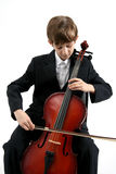 Music of cello. The Boy performs the music on cello royalty free stock photography