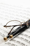 Music charts. With drums stick and glasses on top Royalty Free Stock Photo