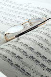Music charts. Percussion and drums music charts with glasses on top Royalty Free Stock Images