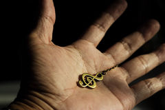Music clef metal on hand Stock Images