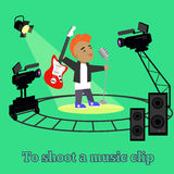 Music clip Shootings Camera and Projector. Music clip shooting camera and projector. Equipment for filming, professional camera on circular rails, it is glowing Stock Photos