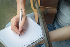 Music Composer Hand Writing Songs. Stock photo stock image