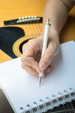 Music Composer Hand Writing Songs. Stock photo stock photography