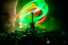 Music concept. Acoustic guitar isolated on a dark background under beam of light with smoke with copy space. Guitar Strings, close. Music concept. Acoustic stock image