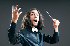 Music concept with  conductor. Music concept with passionate conductor Stock Photo