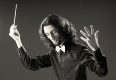 Music concept with  conductor. Music concept with passionate conductor Stock Image