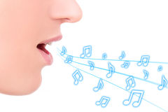 Music concept - female mouth singing over white Stock Image