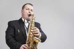 Music Concept and Ideas. Portrait of Caucasian Player in Suit Royalty Free Stock Image