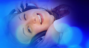 Music concept, pretty woman in large headphones listening to music Royalty Free Stock Photography