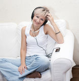 Music concept: young woman with headphones Royalty Free Stock Photo