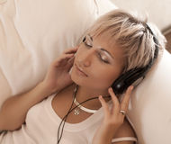 Music concept: young woman with headphones Royalty Free Stock Photos