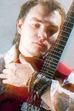 Music Concepts.Closeup Portrait of Young Male Guitar Player Posi Royalty Free Stock Image