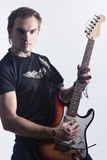 Music Concepts and Ideas. Portrait of caucasian Male Guitar Player Posing With Instrument Against White Stock Photo