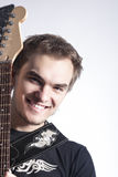 Music Concepts and Ideas. Portrait of caucasian Male Guitar Player Posing With Instrument Royalty Free Stock Photography