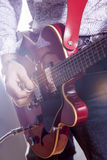 Music Concepts. Male Guitar Player Performing with Electric Guit Royalty Free Stock Images