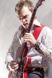 Music Concepts. Professional Male Musician Performing with Elect Royalty Free Stock Photos