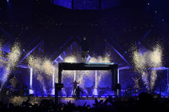 Music Concert Stage, Fireworks, Enthusiastic Crowd, Fans, Spotlights Stock Photography