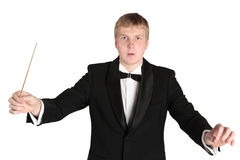 Music conductor. Conductor posing with baton in hand Royalty Free Stock Images
