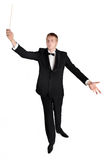 Music conductor. Conductor conducted with baton in hand Stock Photo
