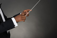 Music Conductor Hands Holding Baton. Close-up Of Music Conductor Hands Holding Baton Stock Photo