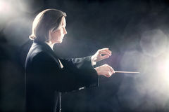 Music conductor inspired maestro. Symphony orchestra conductor in inspiration Stock Photo