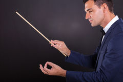 Music conductor. Male music conductor with eyes closed on black background Stock Photography
