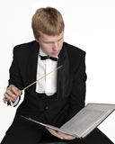 Music conductor with score Royalty Free Stock Image