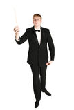 Music conductor at work. Music conductor looking on baton Royalty Free Stock Photography
