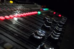 A music console with many buttons and sliders stock images