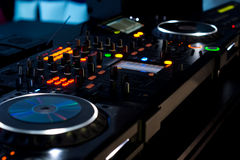 Music deck at a disco illuminated at night Stock Photo