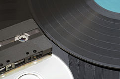 Music Development. Gramophone disk, cd and cassette Stock Images
